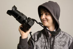 Portrait of cheerful young photographer with a professional came Royalty Free Stock Photography