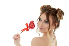 Young woman with lollipop. Stock Image