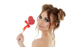 Young woman with lollipop. Stock Images