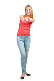 Portrait of cheerful young woman pointing Stock Photo