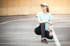 Portrait of cheerful young woman ready to start running session. Stock Photography