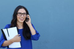 Portrait of cheerful young woman talking on smartphone outdoors. Happy beautiful Hispanic woman using mobile phone, making call Stock Photos