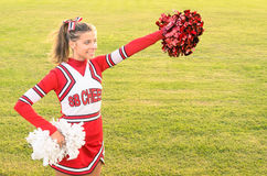 Portrait of a cheerleader in action Stock Photos