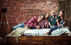 Portrait of a cheerrful family relaxing in a stylish interior royalty free stock image