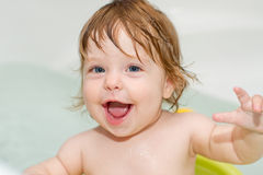 Portrait of cheery cute baby girl in a bath Royalty Free Stock Image