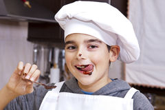 Portrait of chef. Child clothes chef making cakes Royalty Free Stock Photography