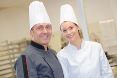Portrait chef with commis chef. Portrait of a chef with his commis chef Royalty Free Stock Photo