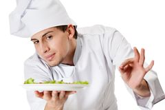 Portrait of chef cook handing salad dish Royalty Free Stock Photos