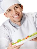 Portrait of chef cook offering salad dish Royalty Free Stock Images