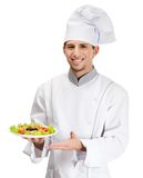 Portrait of chef cook showing salad dish. Isolated on white Stock Images