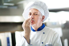 Portrait of a Chef in his Kitchen Stock Photos