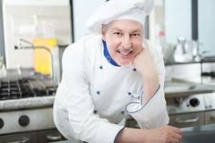 Portrait of a chef in his kitchen Stock Photography