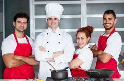 Portrait of a chef with his team. Of restaurant royalty free stock image