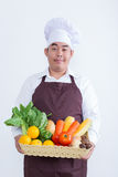 Portrait of a chef holding fruit and vegetable Royalty Free Stock Image
