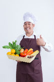 Portrait of a chef holding fruit and vegetable Stock Photo