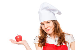 Portrait of a chef holding in the palm of an apple Royalty Free Stock Photos