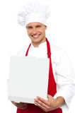 Portrait of a chef holding a pastry box Royalty Free Stock Photography