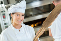Portrait chef holding wooden peel Stock Image