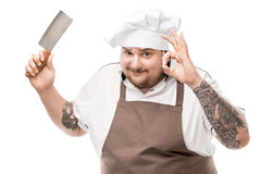 Portrait of chef with knife in hand showing ok sign Royalty Free Stock Photos