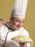 Portrait of a chef with pasta Royalty Free Stock Images