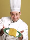 Portrait of a chef with pasta Stock Image