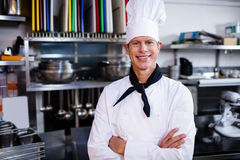 Portrait of chef posing in commercial kitchen Stock Photo