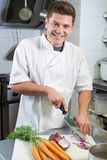 Portrait Of Chef Preparing Vegetables In Restaurant Kitchen stock photos