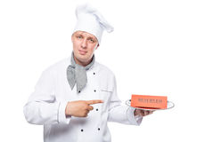 Portrait of a chef with a reserve on a tray isolated on white Stock Photo
