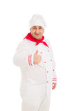 Portrait Of Chef Showing Thumb Up Sign wearing white uniform. Over white background Stock Photos