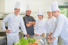 Portrait chef with student chefs. Portrait of chef with his student chefs Royalty Free Stock Photo