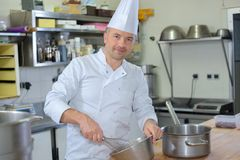 Portrait chef using whisk. Portrait of chef using whisk royalty free stock image