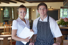 Portrait Of Chef And Waitress In Restaurant Royalty Free Stock Photo