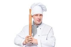 Portrait of a chef with a wooden rolling pin on a white Stock Image
