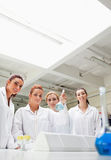 Portrait of chemistry students holding a flask Royalty Free Stock Photo