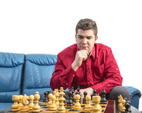 Portrait of a Chess Player. Portrait of a young man thinking during a chess match Royalty Free Stock Photos