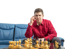 Portrait of a Chess Player. Portrait of a young man thinking during a chess match Royalty Free Stock Photo