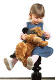 Portrait of a Child. A sweet 18 months old girl cuddles her toy doggie Royalty Free Stock Photography