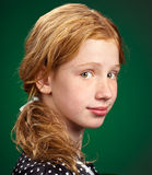Portrait of a child. Portrait of a beautiful young girl on a green background royalty free stock photography