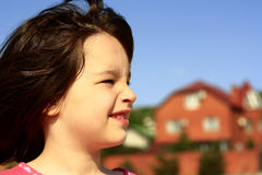 Portrait of a child. Against the backdrop of a beautiful home Stock Photo
