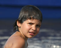 Portrait of the child. On a background of a water smooth surface Stock Image