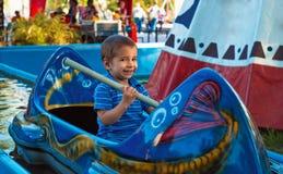 Portrait of a child at an amusement park. Stock Photos