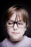 Portrait of a child on a black background. Stock Images