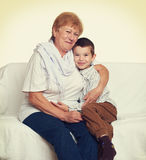 Portrait of child boy and grandmother on white, happy family concept Stock Images