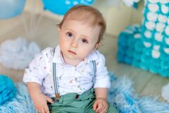 Portrait of a child boy looking at the camera, a child 1 year old, happy childhood, children`s birthday