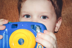 Portrait of a child with a camera. Royalty Free Stock Images