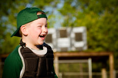 Portrait of child in catchers gear laughing Royalty Free Stock Photos