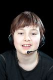 Portrait of the child while chatting. With headphones royalty free stock photography