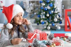 Portrait of a child with Christmas present royalty free stock photography