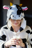 Portrait of child with cow pajamas, breakfast a glass of milk Stock Image