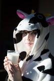 Portrait of child with cow pajamas, breakfast a glass of milk Stock Photography